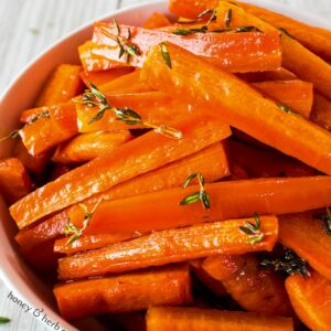 Easy Honey and Herb Oven Roasted Carrots are my familys favorite oven roasted carrots flavor!