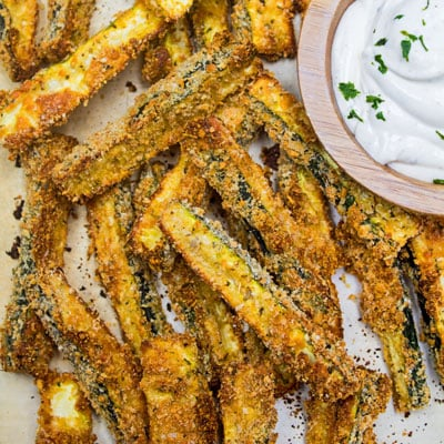 Delicious, tender zucchini coated with a Parmesan bread coating then baked until you have these super tasty crispy baked zucchini fries! @ bakeitwithlove.com