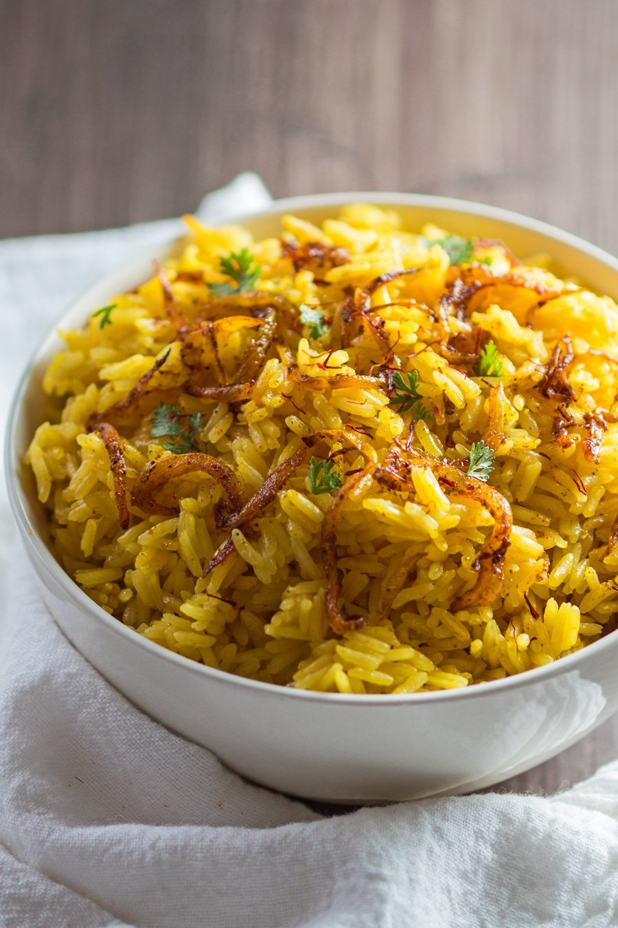 vertical angled side view image of the fragrant saffron jasmine rice ready to serve.
