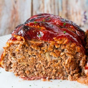 Delicious bacon wrapped meatloaf with a tangy ketchup sauce coating that is cooked to perfection!