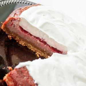 Jello cake on a pie plate with slice missing.