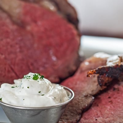 small square image of creamy horseradish sauce in metal bowl.