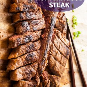 pin image for red miso porterhouse steak showing the pan seared marinated steak after resting cut and ready to serve
