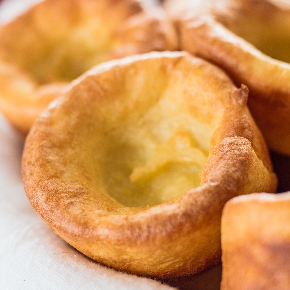 Large square closeup image of yorkshire puddings.
