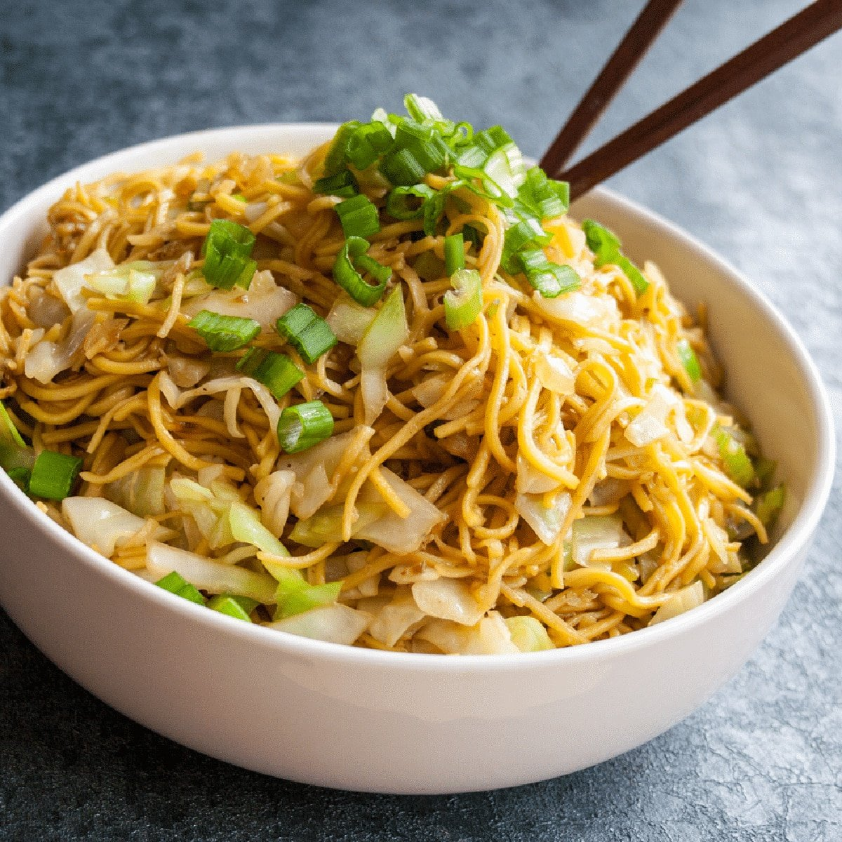 Panda Express Chow Mein in a white bowl with chopsticks.