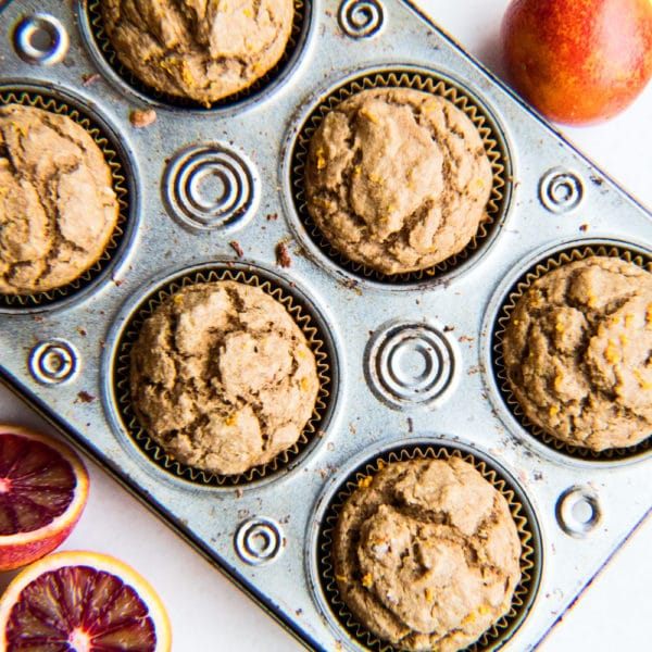 Blood orange muffins in pan.