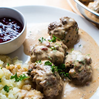 Swedish Meatballs (with Lingonberries) is a delicious classic meal, and a comfort food favorite for the whole family!!