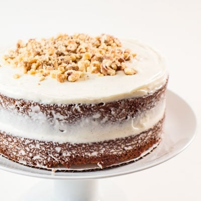 Carrot Cake with Cream Cheese Frosting is the perfect Easter dessert - subtly spiced and topped with a rich vanilla bean cream cheese frosting!