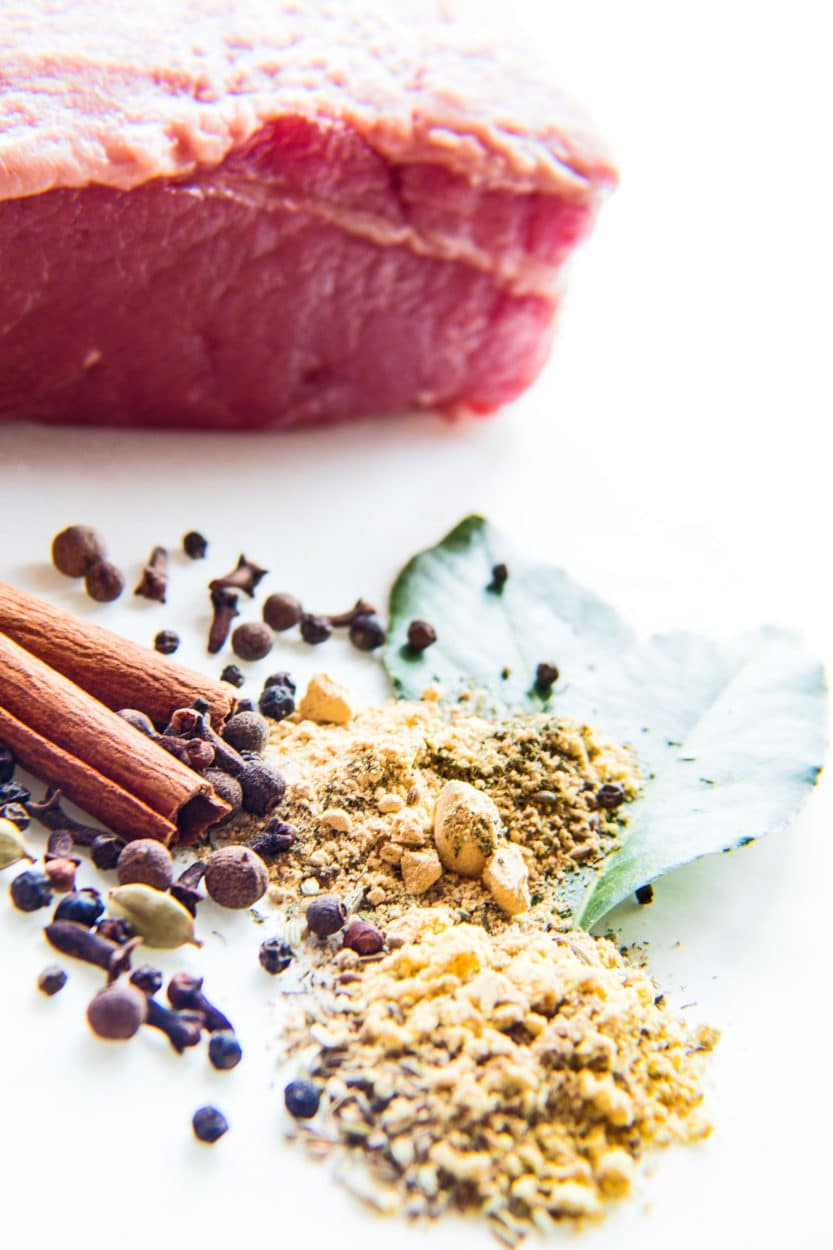 Homemade corned beef and cabbage seasoning mix ingredients on a white background.