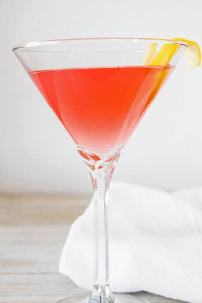 The Cosmopolitan is a delightfully fresh tasting adult version of pink lemonade that is a super easy 4 ingredient cocktail!