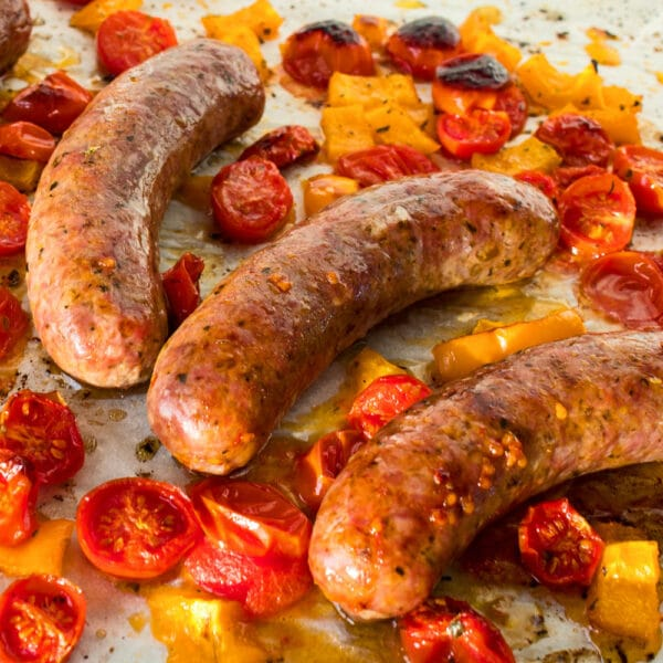 Quick and easy one pan oven baked Italian sausages are a delightfully flavorful dinner that will be a go-to dinner for your busy family!