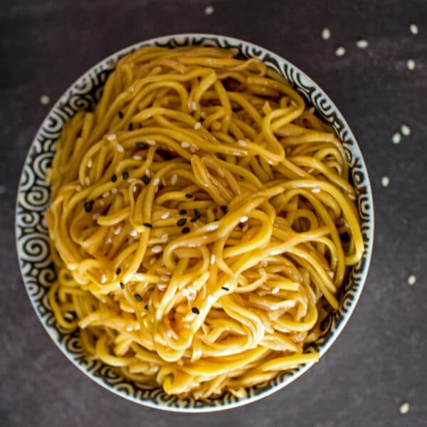Hibachi Noodles in a bowl covered with sesame seeds.