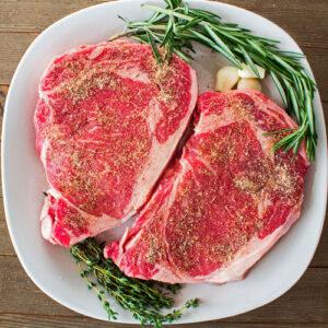 Rib eye steaks at room temperature with my homemade steak seasoning.