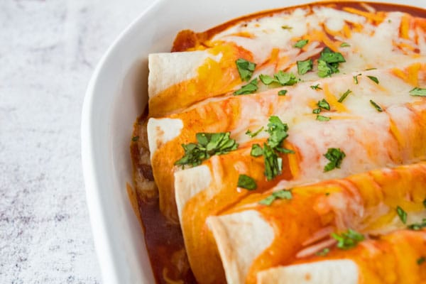 These cheesy chicken enchiladas are an easy to make comfort food and family favorite dinner!