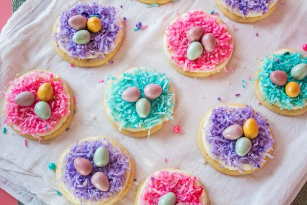 My Easter cookies, completed with buttercream frosting and colored shredded coconut and mini eggs