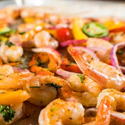 These sheet pan shrimp fajitas are an amazingly easy, tasty, and healthy dinner the whole family will love!