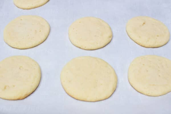 My super soft double sugar cookies baked and cooling on the baking sheet before transferring to a wire cooling rack