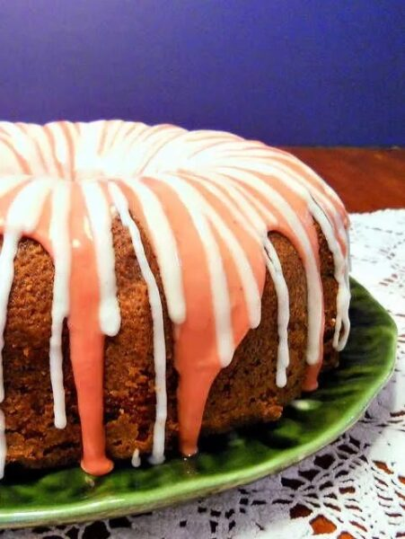 pink and white glaze on pound cake make this strawberry moscato cake from pastry chef online