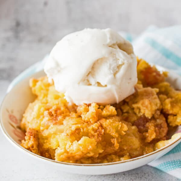 This 3 ingredient apple dump cake, or apple cobbler dump cake, is an incredibly tasty dessert that you can have ready to serve in no time at all!