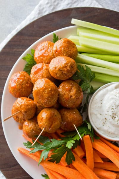 over head image of leftover buffalo turkey meatballs on a tray with carrots, celery, and ranch dressing