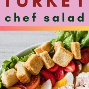 pin image with an overhead image of the chef salad in a large white serving bowl on a grey wooden background a text label in the center and a close up vertical image on the bottom showing the layered turkey meat bacon cheeses had boiled eggs tomatoes and croutons on a bed of leaf lettuce