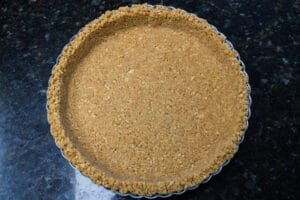 graham cracker crust firmly packed into a baking dish and ready to chill or bake before filling