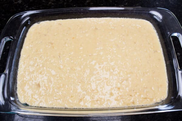 pineapple sunshine cake mixed and poured into baking dish ready to bake