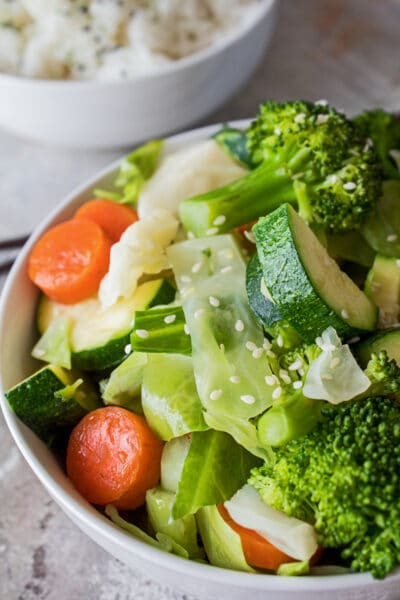 tall vertical image closeup angled from above of the steamed mixxed veggies made in this panda express copycat recipe