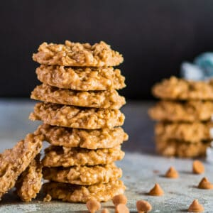 large square image of the butterscotch no bake cookies stacked with morsels around them.