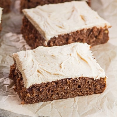 small square image of the frosted and sliced chocolate banana cake