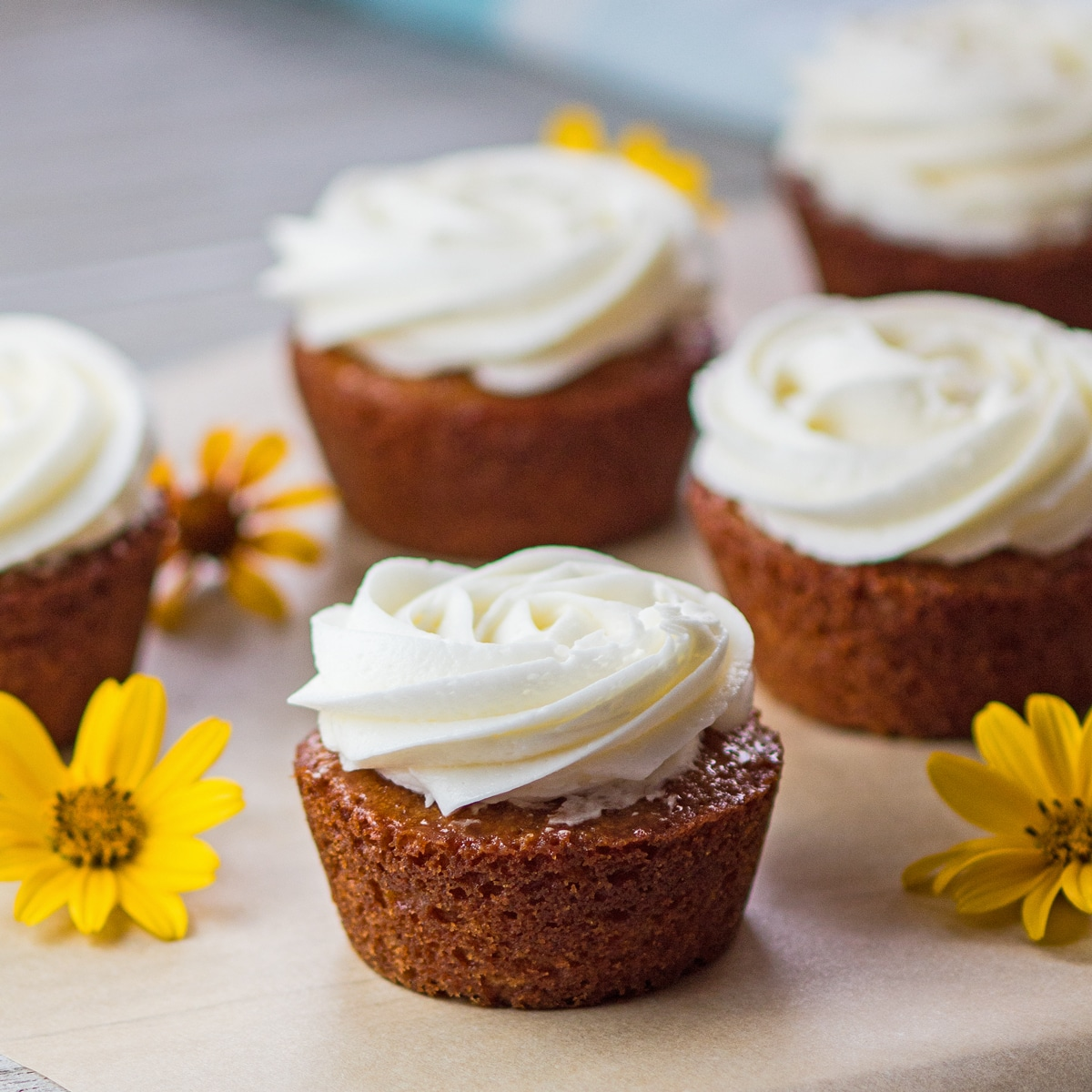 Large square image of delicious honey cakes drizzled with honey and topped with frosting.