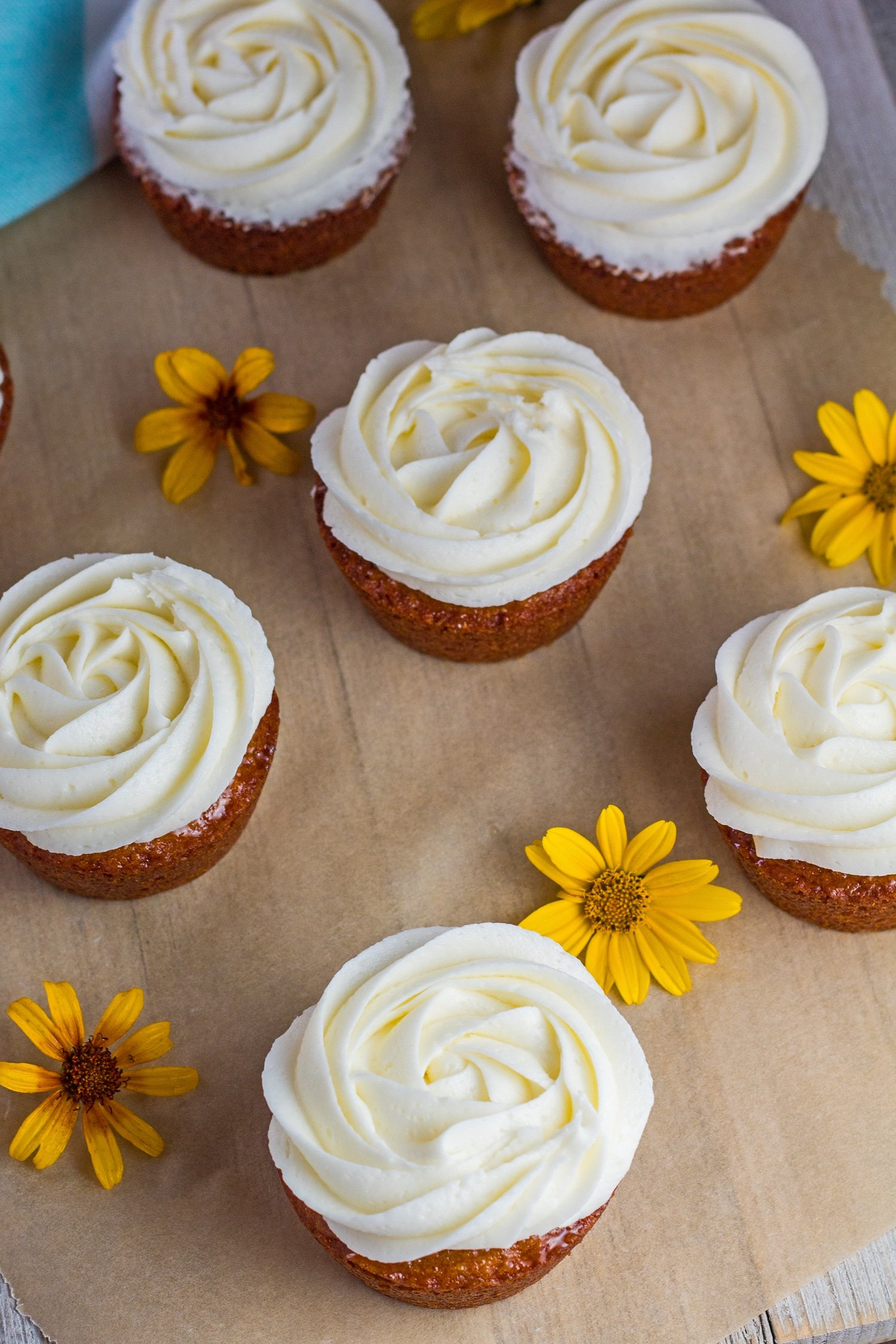 delicious honey cakes topped with orange frosting from an angled overhead view