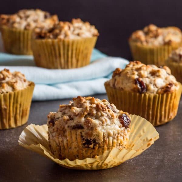 large square image of raising bran muffins on dark background.