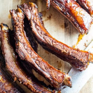 large square image of the sliced smoked beef back ribs on the cutting board.