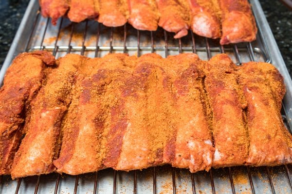 beef back ribs with dry rub seasoning before smoking.