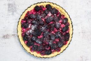 blackberry filled tart shell ready to bake.