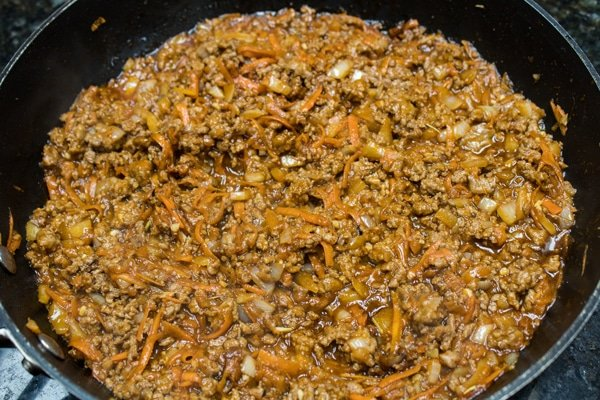 ground lamb meat cooked and ready to assemble into shepherds pie