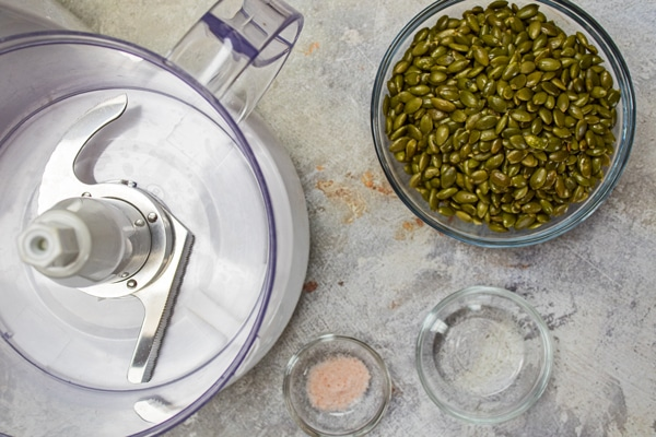 Pumpkin seed butter ingredients with food processor.