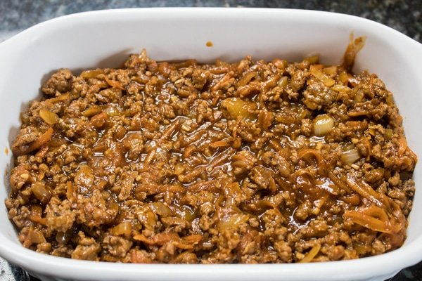 the first layer of the shepherds pie in the baking dish