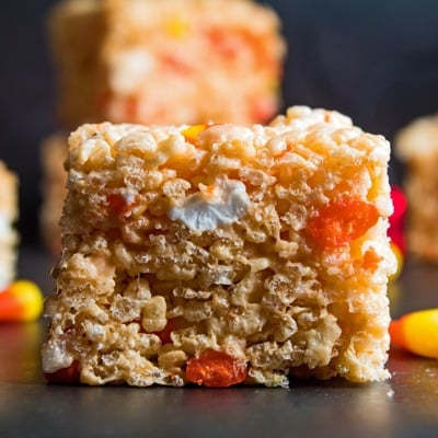 small square straight on image of a cut candy corn rice krispie treat.
