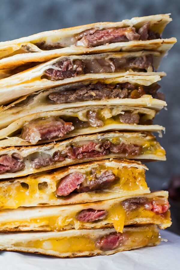 tall image of stacked leftover prime rib quesadillas.