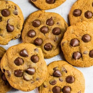 Large square overhead image of pumpkin chocolate chip cookies.