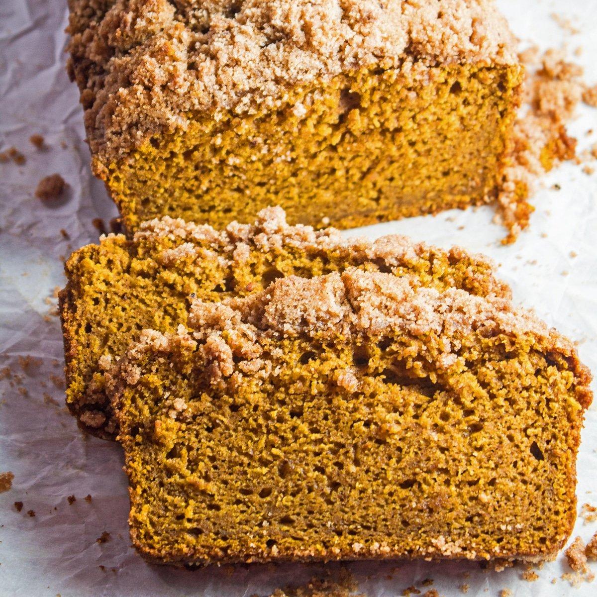 Large closeup on the sliced pumpkin streusel bread.