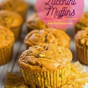pin with tall closeup angled overhead view of the pumpkin zucchini muffins.
