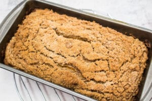 baked pumpkin streusel bread on wire cooling rack.