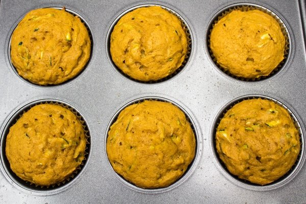 Baked pumpkin zucchini muffins removed from oven.
