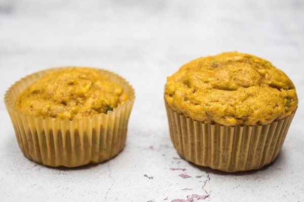 comparison photo of muffins two thirds full and full.