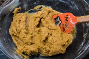 wet and dry ingredients combined to pumpkin cookie dough.