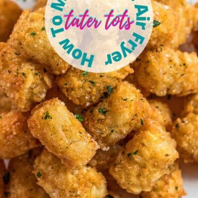 pin with tall angled overhead image of air fryer tater tots and text overlay.