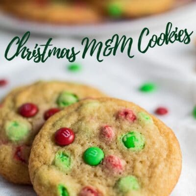 pin with angled overhead image of Christmas M&M cookies on white background.